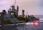 Image of USS Drayton (DD-366) in camouflage paint off coast of Iwo Jima Pacific Ocean, 1944, second 9 stock footage video 65675059676