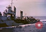 Image of USS Drayton (DD-366) in camouflage paint off coast of Iwo Jima Pacific Ocean, 1944, second 11 stock footage video 65675059676
