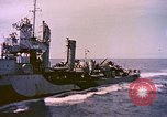 Image of USS Drayton (DD-366) in camouflage paint off coast of Iwo Jima Pacific Ocean, 1944, second 12 stock footage video 65675059676