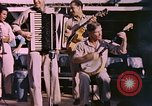 Image of sailors playing instruments Pacific Ocean, 1944, second 3 stock footage video 65675059679