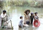 Image of Natives washing clothes in a river Leyte Philippines, 1945, second 1 stock footage video 65675059733
