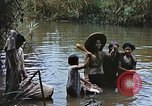Image of Natives washing clothes in a river Leyte Philippines, 1945, second 2 stock footage video 65675059733
