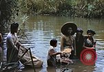 Image of Natives washing clothes in a river Leyte Philippines, 1945, second 3 stock footage video 65675059733