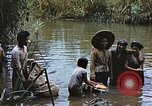 Image of Natives washing clothes in a river Leyte Philippines, 1945, second 4 stock footage video 65675059733