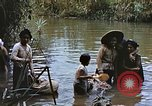 Image of Natives washing clothes in a river Leyte Philippines, 1945, second 5 stock footage video 65675059733