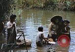 Image of Natives washing clothes in a river Leyte Philippines, 1945, second 6 stock footage video 65675059733