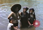 Image of Natives washing clothes in a river Leyte Philippines, 1945, second 10 stock footage video 65675059733