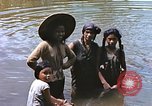 Image of Natives washing clothes in a river Leyte Philippines, 1945, second 11 stock footage video 65675059733