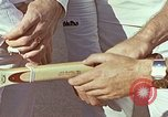 Image of Tennis champion Bobbie Riggs demonstrates racquet grip Waikiki Hawaii USA, 1945, second 11 stock footage video 65675059779