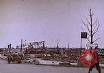 Image of WW2 bombing damage and Imperial Palace grounds Tokyo Japan, 1945, second 3 stock footage video 65675059786