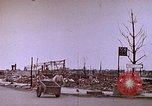 Image of WW2 bombing damage and Imperial Palace grounds Tokyo Japan, 1945, second 6 stock footage video 65675059786