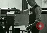 Image of hand press United States USA, 1923, second 2 stock footage video 65675059838