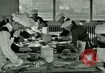 Image of cooking classes for American boys and girls United States USA, 1923, second 4 stock footage video 65675059847