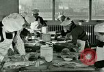 Image of cooking classes for American boys and girls United States USA, 1923, second 7 stock footage video 65675059847