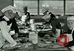 Image of cooking classes for American boys and girls United States USA, 1923, second 9 stock footage video 65675059847