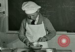 Image of cooking classes for American boys and girls United States USA, 1923, second 10 stock footage video 65675059847