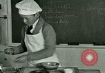 Image of cooking classes for American boys and girls United States USA, 1923, second 11 stock footage video 65675059847
