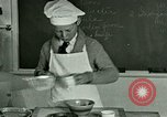 Image of cooking classes for American boys and girls United States USA, 1923, second 12 stock footage video 65675059847