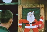 Image of troops celebrate Christmas Vietnam, 1968, second 4 stock footage video 65675059895