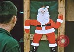 Image of troops celebrate Christmas Vietnam, 1968, second 7 stock footage video 65675059895