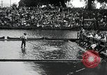 Image of logrolling Longview Washington USA, 1930, second 4 stock footage video 65675059954