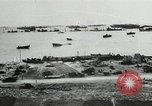 Image of Allied troops and equipment being brought ashore on Omaha Beach Normandy France, 1944, second 9 stock footage video 65675060099