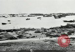 Image of Allied troops and equipment being brought ashore on Omaha Beach Normandy France, 1944, second 11 stock footage video 65675060099