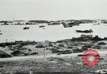 Image of Allied troops and equipment being brought ashore on Omaha Beach Normandy France, 1944, second 12 stock footage video 65675060099