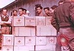 Image of Liberated American airmen and Red Cross aid at Stalag 7A prison camp Moosburg Germany, 1945, second 1 stock footage video 65675060145