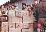 Image of Liberated American airmen and Red Cross aid at Stalag 7A prison camp Moosburg Germany, 1945, second 2 stock footage video 65675060145