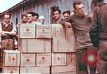 Image of Liberated American airmen and Red Cross aid at Stalag 7A prison camp Moosburg Germany, 1945, second 3 stock footage video 65675060145