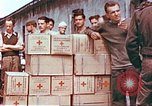 Image of Liberated American airmen and Red Cross aid at Stalag 7A prison camp Moosburg Germany, 1945, second 4 stock footage video 65675060145