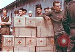 Image of Liberated American airmen and Red Cross aid at Stalag 7A prison camp Moosburg Germany, 1945, second 5 stock footage video 65675060145