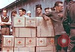 Image of Liberated American airmen and Red Cross aid at Stalag 7A prison camp Moosburg Germany, 1945, second 6 stock footage video 65675060145