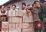 Image of Liberated American airmen and Red Cross aid at Stalag 7A prison camp Moosburg Germany, 1945, second 7 stock footage video 65675060145