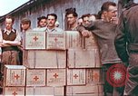 Image of Liberated American airmen and Red Cross aid at Stalag 7A prison camp Moosburg Germany, 1945, second 8 stock footage video 65675060145