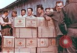 Image of Liberated American airmen and Red Cross aid at Stalag 7A prison camp Moosburg Germany, 1945, second 9 stock footage video 65675060145