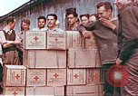 Image of Liberated American airmen and Red Cross aid at Stalag 7A prison camp Moosburg Germany, 1945, second 10 stock footage video 65675060145