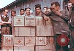 Image of Liberated American airmen and Red Cross aid at Stalag 7A prison camp Moosburg Germany, 1945, second 11 stock footage video 65675060145