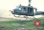 Image of wounded soldiers airlifted via UH-1 Huey helicopter Saigon Vietnam Cu Chi, 1966, second 7 stock footage video 65675060266