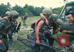 Image of wounded soldiers airlifted via UH-1 Huey helicopter Saigon Vietnam Cu Chi, 1966, second 9 stock footage video 65675060266