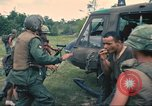 Image of wounded soldiers airlifted via UH-1 Huey helicopter Saigon Vietnam Cu Chi, 1966, second 11 stock footage video 65675060266