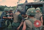 Image of wounded soldiers airlifted via UH-1 Huey helicopter Saigon Vietnam Cu Chi, 1966, second 12 stock footage video 65675060266