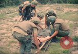 Image of Bell UH-1B Iroquois Huey helicopter airlifts wounded Saigon Vietnam Cu Chi, 1966, second 7 stock footage video 65675060267