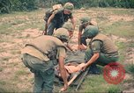Image of Bell UH-1B Iroquois Huey helicopter airlifts wounded Saigon Vietnam Cu Chi, 1966, second 8 stock footage video 65675060267
