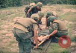 Image of Bell UH-1B Iroquois Huey helicopter airlifts wounded Saigon Vietnam Cu Chi, 1966, second 9 stock footage video 65675060267