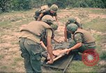 Image of Bell UH-1B Iroquois Huey helicopter airlifts wounded Saigon Vietnam Cu Chi, 1966, second 10 stock footage video 65675060267