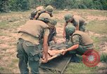 Image of Bell UH-1B Iroquois Huey helicopter airlifts wounded Saigon Vietnam Cu Chi, 1966, second 11 stock footage video 65675060267
