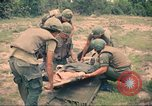 Image of Bell UH-1B Iroquois Huey helicopter airlifts wounded Saigon Vietnam Cu Chi, 1966, second 12 stock footage video 65675060267