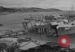 Image of U.S. Army Vehicles being loaded on LSTs before D-Day Falmouth England, 1944, second 7 stock footage video 65675060406